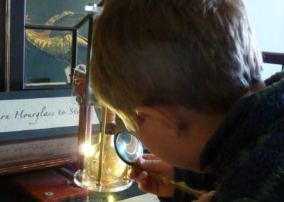 Inspecting the Dragons Gold Hourglass -Ozleworth Cabinet of The Gylde