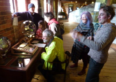 Visitors to Desk of ingenuity at Gloucester Waterways Museum